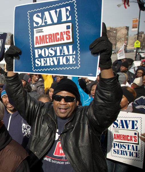 Postal workers in Chicago rally in support of keeping Saturday mail delivery, which the U.S. Postal Service plans to discontinue as a cost-cutting move.