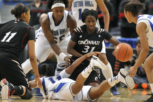 As the Big East Women's Basketball Tournament kicks off, Seton Hall and Cincinnati players battle for a loose ball in their first-round game at XL Center Friday afternoon. Cincinnati players left to right: Tiffany Turner and Dayeesha Hollins. Seton Hall players: Ka-Deidre Simmons, bottom left, Breanna Jones, top left, Brittany Morris, right. Seton Hall won the game, 60-55.