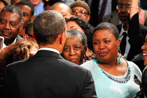 President Barack Obama greets Cleopatra Cowley-Pendleton (right), mother of slain 15-year-old girl Hadiya Pendleton, as he visits Hyde Park Academy in Chicago to discuss gun violence and the economy. Hadiya Pendleton was gunned down as she stood with friends after school in a park that is located just a mile from Obama's Chicago home.