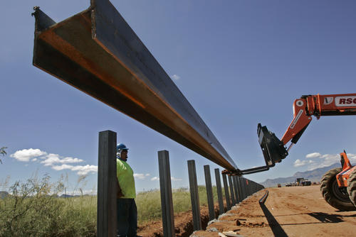Sept. 11, 2007: A steel rail is lifted into position on the new U.S.-Mexico border fence outside of Naco, Ariz.