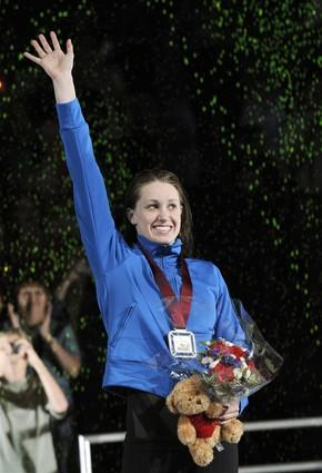 Katie Hoff, the first American to qualify for the Beijing Games in two swimming events, accepts her first-place medal after winning the women's 400-meter freestyle final on Monday.