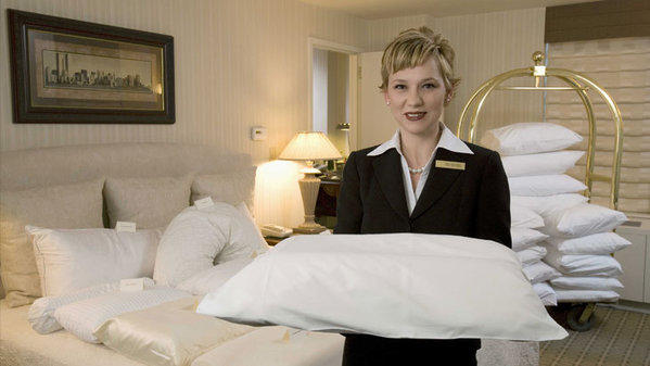A sleep concierge at the Benjamin hotel in New York offers a choice of pillows.