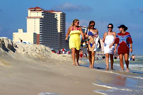 Chelsea Levi, left, Megan Brantley, Shellie Street and Elizabeth Howell take a stroll. The University of Alabama students drove 4 1/2 hours to vacation in Gulf Shores, Ala.
