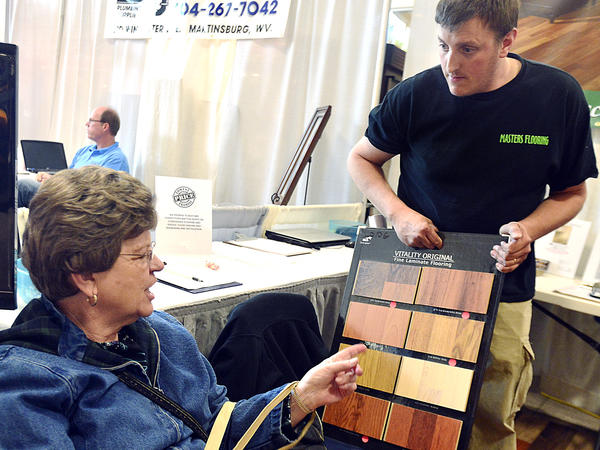 Joyce Omps of Whitacre, Va., is shown flooring samples by Ronnie Masters, owner of Masters Flooring Friday at the Eastern Panhandle Home Show at the Martinsburg Mall.