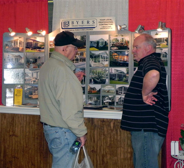 Steve Dubpernell, Greencastle, discussed home renovations with James Byers of Byers Home Improvement in Greencastle, Pa., at the 30th annual Franklin County (Pa.) Builders Show held at the Waynesboro Mall off Pa. 16 on Friday.