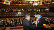 CARACAS, Venezuela -- Venezuela's new interim president, Nicolas Maduro, gave a clear sign Friday night that he will use political capital left by the late President Hugo Chavez to win election in his own right.