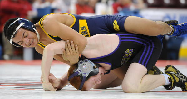 (Bottom) Palisades' Jacob Wasser is defeated by Saegertown's Devin Brown with a score of 5-0 in the 106 pound weight class in the semifinals of the PIAA Class 2A Wrestling Championships held at the Giant Center in Hershey on Friday.
