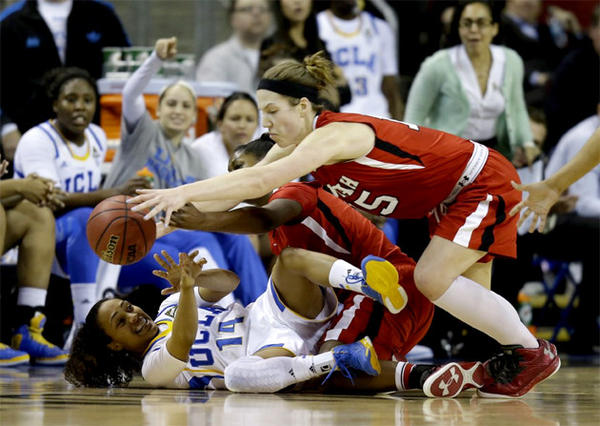 UCLA's Mariah Williams (14) battles for a loose ball with Utah's Michelle Plouffe.
