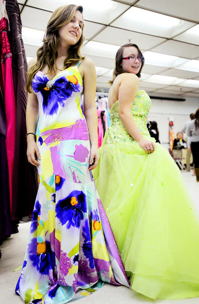 Washington County Technical High School juniors Kelsey Cooper, left, and Cheyanne Morgan tried on several dresses Friday evening during the annual Cinderella's Closet event at Washington County Technical High School.