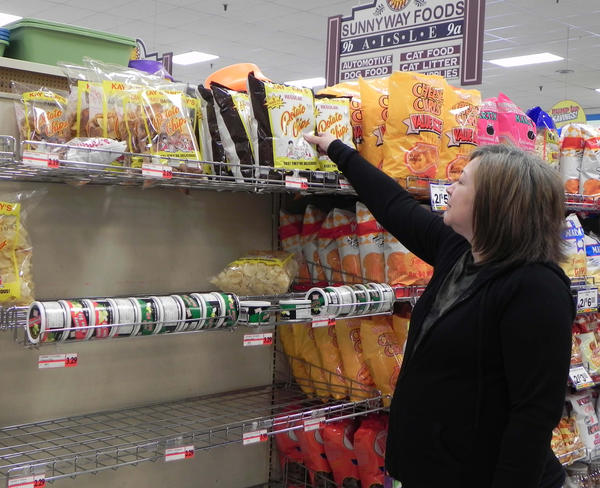 "Sandie Collins-Keener, Greencastle, Pa., said saying goodbye to the iconic brand was ""so sad,"" as she reaches for one last bag off the shelves at Sunnyway Foods in Greencastle (Pa.) on Friday."