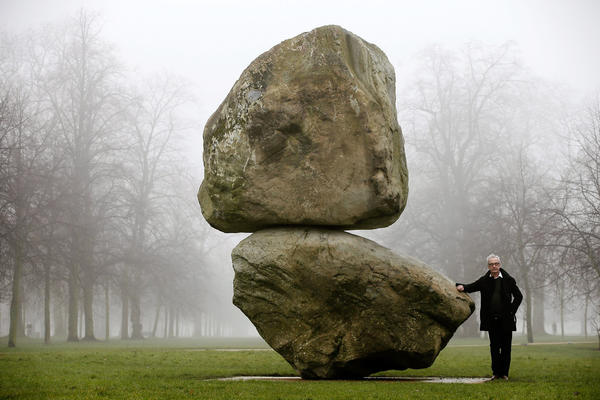 "LONDON, ENGLAND - MARCH 08:  Artist Peter Fischli poses next to ""Rock on Top of Another Rock"", in Hyde Park on March 8, 2013 in London, England. The piece, commissioned by the Serpentine Gallery, was created by the artistic duo Fischli/Weiss, and was one of the last works they jointly conceived before David Weiss's death last year.  (Photo by Matthew Lloyd/Getty Images)  *** BESTPIX *** ORG XMIT: 147182386"