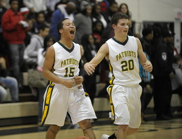 Stevenson's Jalen Brunson (15) unleashed a scream after the final buzzer. Stevenson defeated North Chicago 73-58 on Wednesday, February 20, 2013.