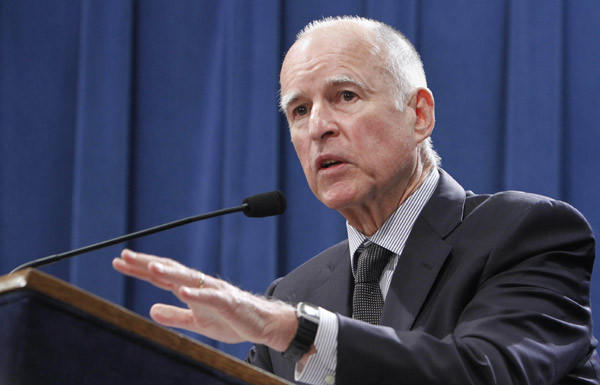 Gov. Jerry Brown discusses his proposal to roll back public employee pension benefits during a news conference at the Capitol in Sacramento.