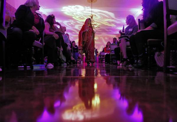 "Omni Patel models a traditional zardosi sari during ""Indian Weddings 101"" at the Ebell of Los Angeles club."