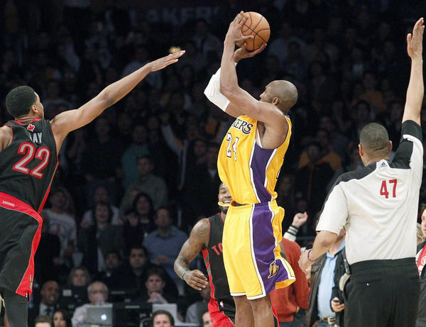 Kobe Bryant takes a three-point shot that ties the score at the end of the fourth quarter against the Toronto Raptors.