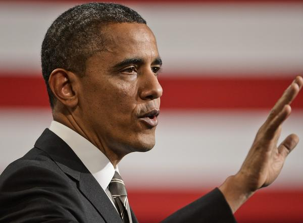 President Obama speaks at Hyde Park Academy in Chicago, Ill. Obama is calling for a raise to the federal minimum wage.