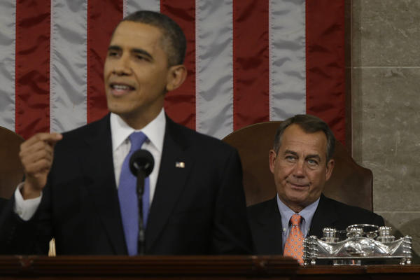 President Obama, left, delivers the State of the Union address to a joint session of Congress as House Speaker John Boehner, a Republican from Ohio, right, looks on at the Capitol in Washington, D.C.