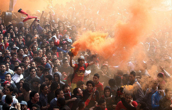 Cairo soccer club fans celebrate after an Egyptian court upholds death sentences for 21 people convicted of inciting a February 2012 riot that killed 74 people.