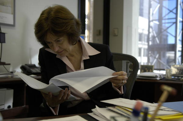 U.S. District Judge Joan Lefkow looks over a case before she goes into the courtroom in November 2005.
