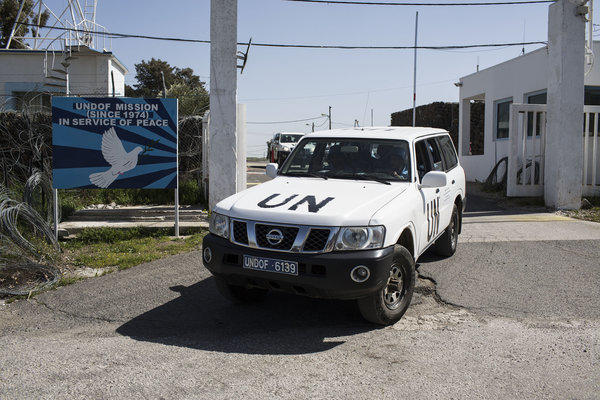 U.N. military drive a vehicle in the Golan Heights region along Israel's border with Syria.