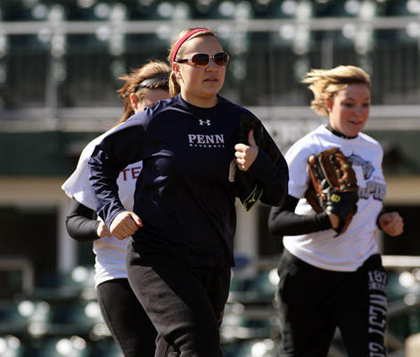 Kayla Bet, 18, of Whitehall, and other girls run onto the field, during ball girl try outs for the Iron Pigs at Coca Cola Park in Allentown Saturday March 9, 2013.