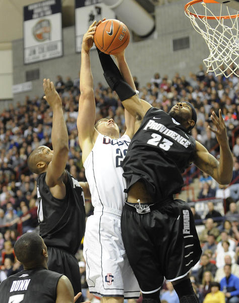 Connecticut Huskies forward Leon Tolksdorf (22) is denied by Providence Friars forward LaDontae Henton (23) in the first half at Gampel Pavilion in their season finale Saturday afternoon.
