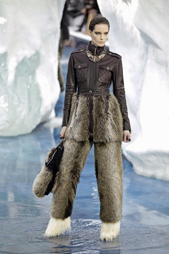 "‬‪In a season largely defined by restraint, it was odd to see so much fur on the runways — even though companies such as Denmark-based Saga Furs give pelts to designers for free, as long as they agree to use them in their runway designs.<br> <br> These furs were not the jewel-encrusted astrakhans and broadtails that we have seen in seasons past. They were furs with a sportier edge, and some of them weren't even real.‬‪ ‬‪<br> <br> At times, the use of fur seemed to be a defiant stand against restraint, as was the case at <a href=""http://latimesblogs.latimes.com/alltherage/2010/03/paris-fashion-week-at-balenciaga-balmain-and-rick-owens-its-all-in-the-packaging.html""><b>Rick Owens</b></a>. He, more than any other designer, has changed the look of fur. And this season, he used it liberally, in  draped kangaroo fur coats with the ease of sweaters and in full-length minks with helmet-like hoods.<br> <br> In other cases, designers seemed to be using fur in such an over-the-top way that it had to be a joke about the industry's dependence on fur as an easy shorthand for luxury and glamour. At <a href=""http://latimesblogs.latimes.com/alltherage/2010/03/paris-fashion-week-maison-martin-margielas-quirky-take-on-the-masculine-feminine-trend.html""><b>Martin Margiela</b></a>, for example, the Russian-style fur cap was rendered so enormous, with flaps hanging down over the arms, that it looked as if it might swallow the model whole.<br> <br> But the biggest news in fur on the runways was that it wasn't all real, and the fake stuff is what looked the most fresh and new.<br> <br> For those anti-fur advocates out there, <a href=""http://latimesblogs.latimes.com/alltherage/2010/03/paris-fashion-week-at-nina-ricci-romance-wins-out.html""><b>Nina Ricci</b></a> featured faux fur trim on a slouchy moleskin coat and soft knit cardigans. It was an even bigger surprise to see fake fur at luxury powerhouse <a href=""http://latimesblogs.latimes.com/alltherage/2010/03/paris-fashion-week-chanels-big-chill.html""><b>Chanel</b></a>, where the runway was a winter wonderland with real icebergs imported from Sweden.<br> <br> We're not talking a little fake fur trim here and there. There was fake fur everywhere, from the moment the curtain went up on four models, covered head to toe in the shaggy stuff, looking like friendly beasts moored on a melting iceberg. There was fake fur trim on boucle suits and fake fur waders, bloomers, mukluk boots and puffball purses.<br> <br> The ""fantasy fur,"" as designer &"