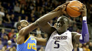 UCLA shook off a disappointing loss Wednesday at last-place Washington State to secure the Pac-12 Conference regular-season title with a 61-54 victory over Washington on Saturday.