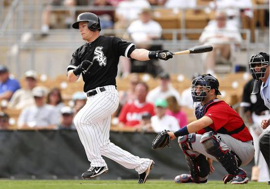Gordon Beckham hits a single against Team USA during a game at Camelback Ranch.