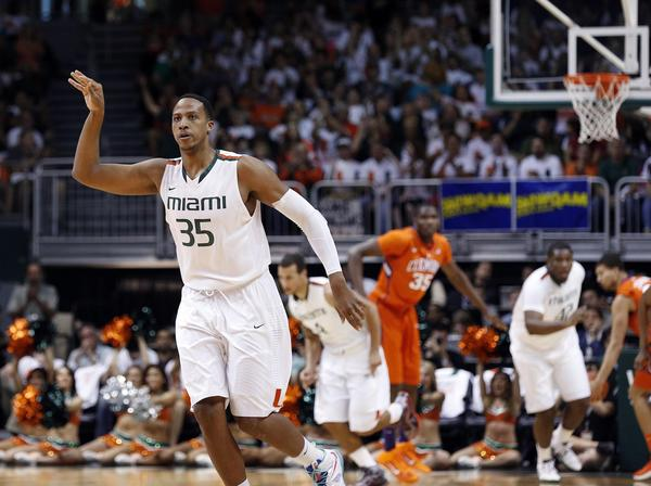 The Miami Hurricanes get 23 points and 10 rebounds from Kenny Kadji and outscore Clemson 37-24 in the second half to win 62-49 and clinch UM's first solo ACC regular-season championship.