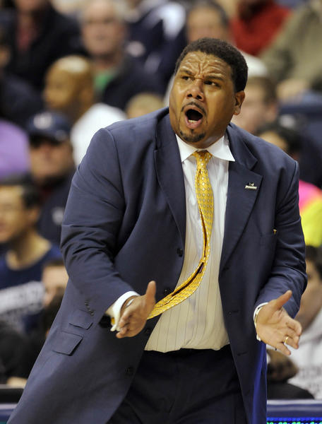Providence Friars head coach Ed Cooley yells encouragement to his team during the game against UConn at Gampel Pavilion in the Huskies' season finale Saturday afternoon.