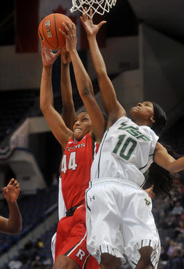 Rutgers forward Betnijah Laney grabs a rebound as USF's Courtney Williams contests in a second round game at the Big East Women's Basketball Tournament at XL Center Saturday afternoon. St. John's won 51-45.