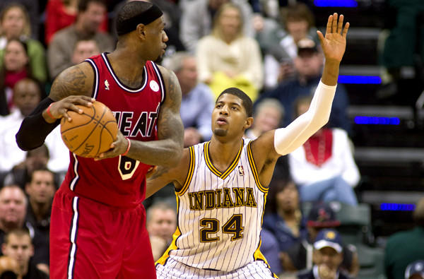 Pacers guard Paul George (24) defends against Heat forard LeBron James during the second half of a game last month in Indianapolis.