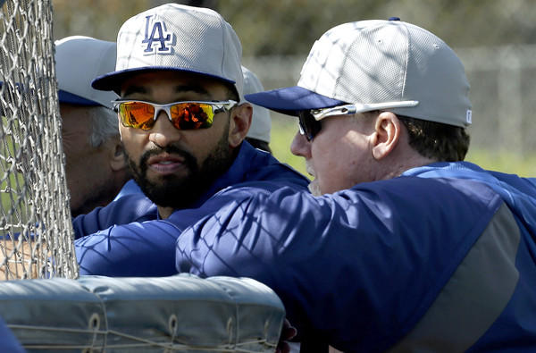Dodgers center fielder Matt Kemp, left, talks with hitting coach Mark McGwire during a workout at spring training last month.