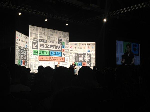 Elon Musk, right, talks about the latest SpaceX rocket launch during his keynote at South by Southwest.