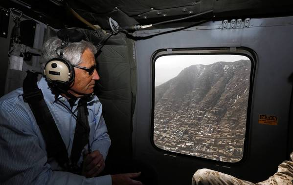 U.S. Defense Secretary Chuck Hagel looks out onto Kabul, the Afghan capital, during his helicopter flight Saturday to Bagram air field.