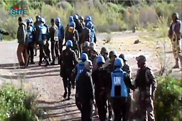 An image from video shows Philippine U.N. peacekeepers crossing into Jordan after being released by Syrian rebels.