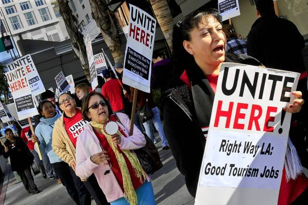 Hotel workers protest during a one-day strike in downtown Los Angeles in 2011. Labor experts credit UNITE Here, the national workers union that pushed a successful minimum wage measure in Long Beach, with adopting the ballot-box strategy early on.