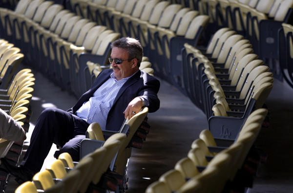 Dodgers General Manager Ned Colletti relaxes in the seats before an exhibition game against the Angels last spring at Dodger Stadium.