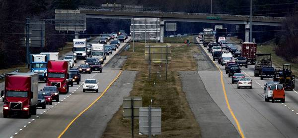 Heavy traffic moves along Interstate 64 near Bland Boulevard in Newport News. A plan would widen the highway from this point up to Exit 247 at Lee Hall.