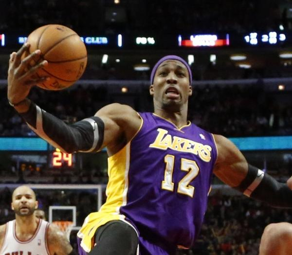 Lakers center Dwight Howard battles Bulls center Joakim Noah for a rebound during a game earlier this season.