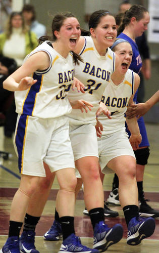 From left, Bacon Academy's Carlee Putnam, Taylor McLaughlin and Sarah Rogers going to greet their teammates after defeating Tolland 33-27.