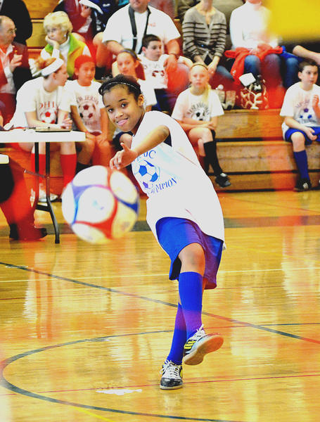 Asha Thomas fires into the net Saturday at the Mid-Atlantic Elks Invitational Soccer Shoot in South Hagerstown High School gymnasium. The 11-year-old came from Abingdon in Harford Co. Maryland.