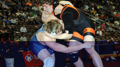 Somerset's Jacob Nickelson, right, wrestles Muncy's Skylar Ebner at the PIAA state tournament Saturday in Hershey.