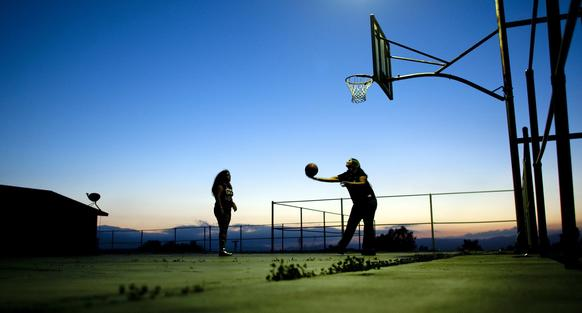 Denise Silvas-Thomas plays basketball with her daughter, Shayna Silvas-Thomas, 10, on the same outdoor court her nephew, Oregon State senior Joe Burton, grew up playing on at the Soboba Indian Reservation