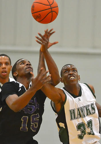 ASA's Quillar Marion left and HCC's Kervin Rameau chase loose ball late in 1st half Saturday night.