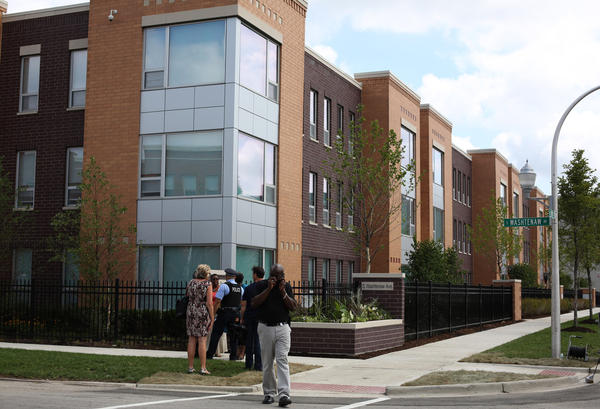 On July 31, 2012 a group gathered, including Mayor Rahm Emanuel, for a ceremony heralding the completion of the first stage of the new mixed-income Park Douglas apartments located on the corner of 13th Street and Washtenaw Avenue in Chicago. (Abel Uribe/ Chicago Tribune)
