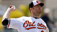Orioles' Chris Tillman scratched from start with abdominal soreness