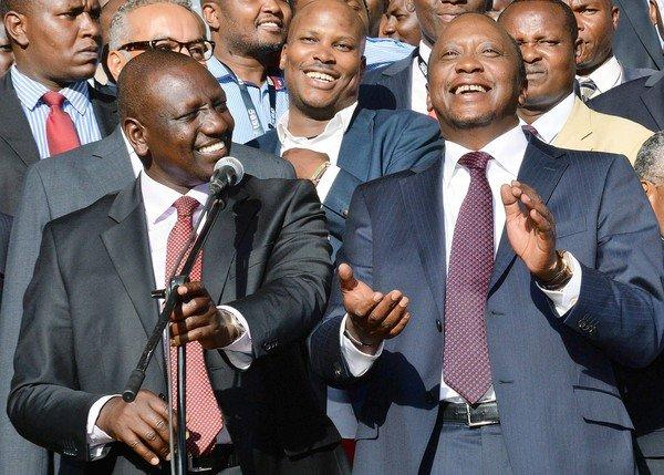 Newly elected Kenyan President Uhuru Kenyatta, right, and running mate William Ruto celebrate their victory at a rally in Nairobi.