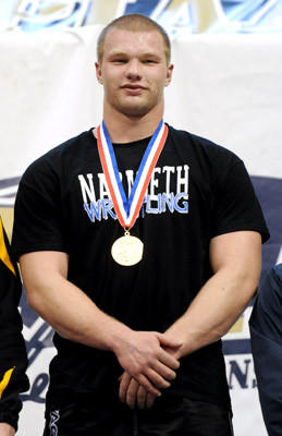 Nazareth's Aaron Bradley receives his gold medal after he defeats Central Tech's Andrew Welton by fall in 5:04 in the 285 pound weight class in the finals of the PIAA Class 3A Wrestling Championships held at the Giant Center in Hershey on Saturday.